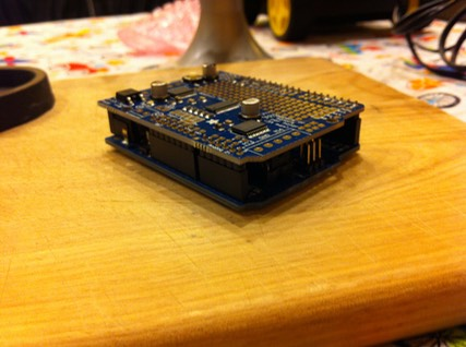 (The Adafruit Motor Shield V2 stacked on top of an Arduino Uno)